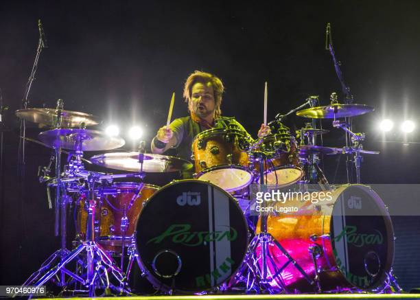Rikki Rockett of Poison performs during the Nothin' But a Good Time Tour 2018 at DTE Energy Music Theater on June 8 2018 in Clarkston Michigan
