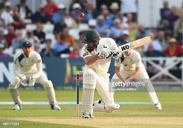 Rikki Wessels of Nottinghamshire takes evasive action from a bouncer off Jack Brooks of Yorkshire during the LV County Championship match between...