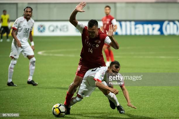 Riko Simanjuntak of Persija Jakarta is fouled by Fazli Ayob Home United during the AFC Cup Zonal Semi final between Home United and Persija Jakarta...