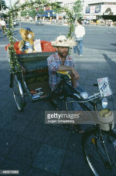 A rikscha or cycle rickshaw waiting for a fare in West Berlin Germany 1983