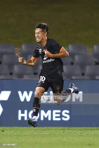 Riku Danzaki of the Roar celebrates scoring a goal during the A-League match between Macarthur FC and the Brisbane Roar at Campbelltown Stadium, on...
