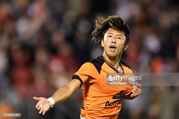 Riku Danzaki of the Roar celebrates with team mates after scoring a goal during the A-League match between the Brisbane Roar FC and Western Sydney...