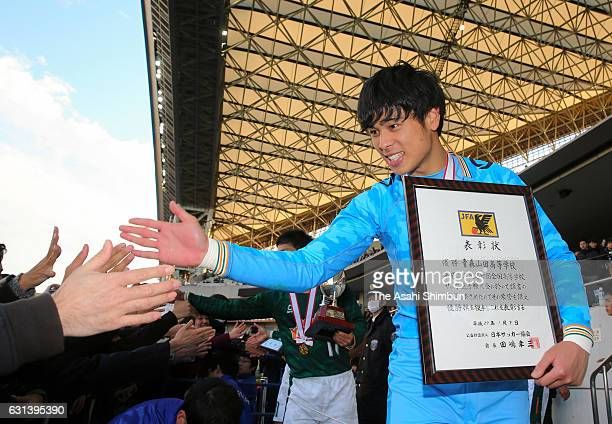Riku Hirosue of Aomori Yamada high fives with supporters after the award ceremony of the 95th All Japan High School Soccer Tournament final match...