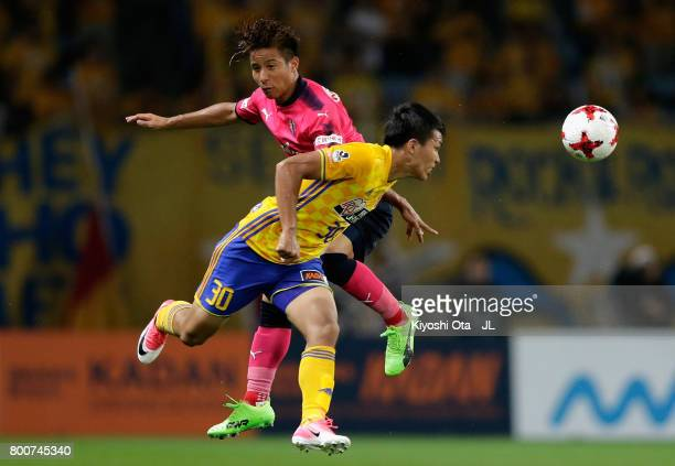 Riku Matsuda of Cerezo Osaka and Takuma Nishimura of Vegalta Sendai compete for the ball during the J.League J1 match between Vegalta Sendai and...