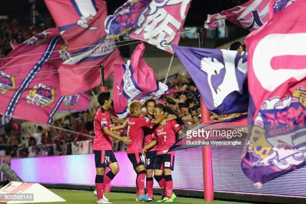 Riku Matsuda of Cerezo Osaka celebrates scoring his side's second goal with his team mates Kota Mizunuma Yoichiro Kakitani and Kazuya Yamamura during...