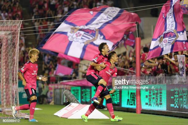 Riku Matsuda of Cerezo Osaka celebrates scoring his side's second goal with his team mates Kota Mizunuma and Yoichiro Kakitani during the JLeague J1...