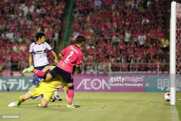 Riku Matsuda of Cerezo Osaka scores his side's second goal past Akihiro Hayashi of FC Tokyo during the JLeague J1 match between Cerezo Osaka and FC...