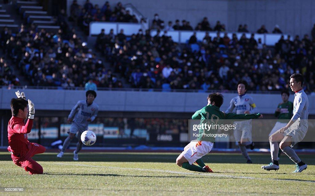 Riku Saga (2nd R) of Aomori Yamada scores his team's second goal during the 94th All Japan High School Soccer Tournament second round match between Aomori Yamada and Seiwa Gakuen at Todoroki Stadium on January 2, 2016 in Kawasaki, Kanagawa, Japan.