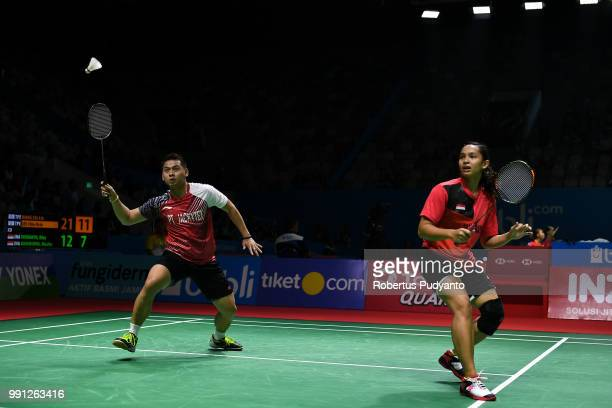 Riky Widianto and Masita Mahmudin of Indonesia compete against Wang ChiLin and Lee Chia Hsin of Chinese Taipei during the Mixed Doubles Round 1 match...