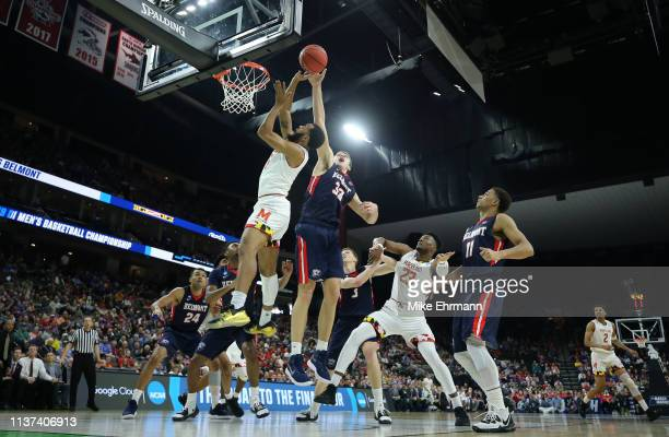 Rilee Epley of the Belmont Bruins blocks a shot by Adam Kunkel of the Belmont Bruins in the first half during the first round of the 2019 NCAA Men's...