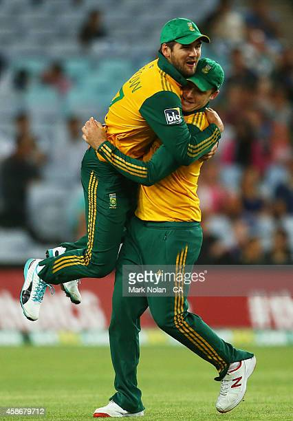 Rilee Rossouw and David Miller of South Afrcia celebtrate a wicket during game three of the Men's International Twenty20 series between Australia and...