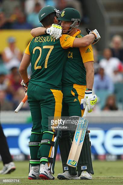 Rilee Rossouw of South Africa celebrates his half century with David Miller of South Africa during the 2015 ICC Cricket World Cup match between South...