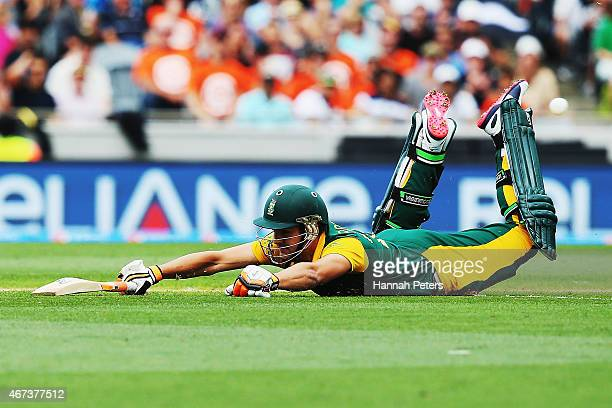 Rilee Rossouw of South Africa dives back into his crease during the 2015 Cricket World Cup Semi Final match between New Zealand and South Africa at...