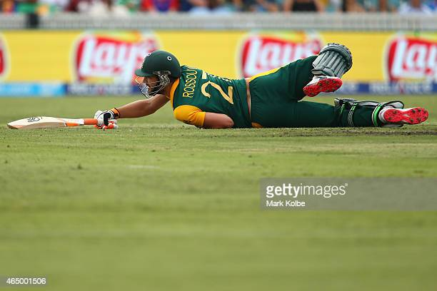 Rilee Rossouw of South Africa falls as he bats during the 2015 ICC Cricket World Cup match between South Africa and Ireland at Manuka Oval on March 3...