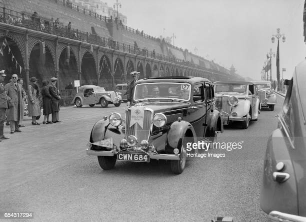 Riley 4door saloon of AS Bassett at the RAC Rally Madeira Drive Brighton 1939 Artist Bill Brunell Riley 4door saloon 1496 cc Reg No CWN684 Entry No...