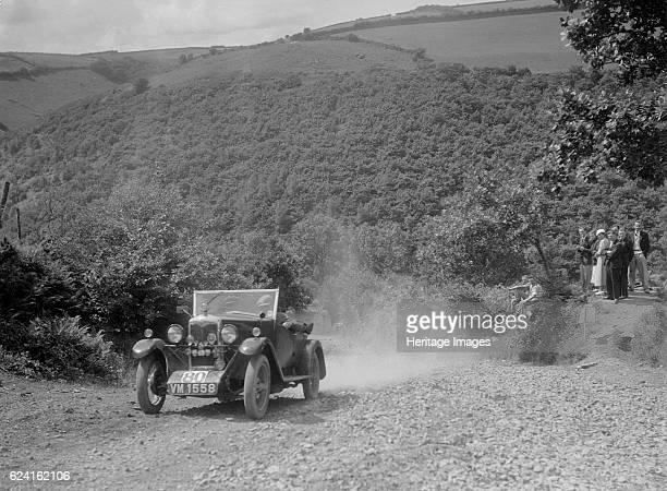 Riley 9 open 4seater tourer at the Mid Surrey AC Barnstaple Trial Beggars Roost Devon 1934 Artist Bill BrunellRiley Nine Tourer 1928 1089 cc Vehicle...