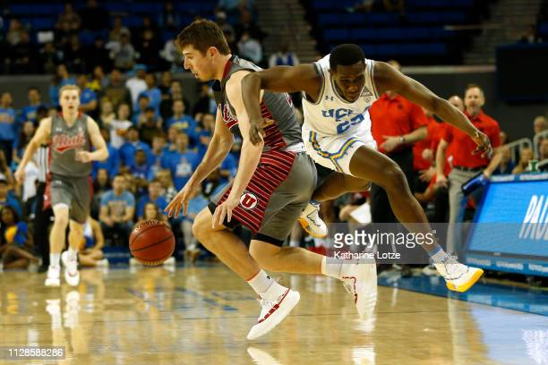 Riley Battin of the Utah Utes and Prince Ali of the UCLA Bruins collide at half court during a game at Pauley Pavilion on February 09 2019 in Los...