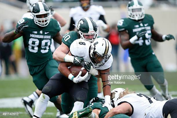 Riley Bullough of the Michigan State Spartans makes a tackle for loss against Markell Jones of the Purdue Boilermakers in the first quarter at...