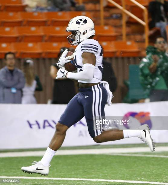 Riley Burt of the BYU Cougars runs into the end zone to score a touchdown during the second half of the game against the Hawaii Rainbow Warriors at...