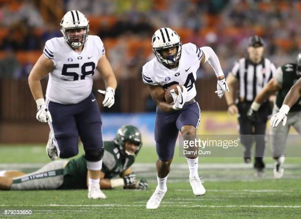 Riley Burt of the BYU Cougars runs past the defense to score a touchdown during the second half of the game against the Hawaii Rainbow Warriors at...