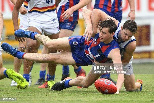 Riley CollierDawkins of Oakleigh is tackled compete for the ball during the round one TAC Cup match between Oakleigh and Eastern at Frankston Oval on...