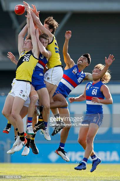 Riley CollierDawkins of Richmond attempts to mark the ball during the round 14 VFL match between the Footscray Bulldogs and the Richmond Tigers at...
