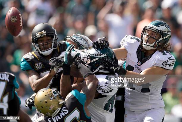 Riley Cooper and Jordan Matthews of the Philadelphia Eagles go up for a hail mary pass as Dwayne Gratz and Josh Evans of the Jacksonville Jaguars...