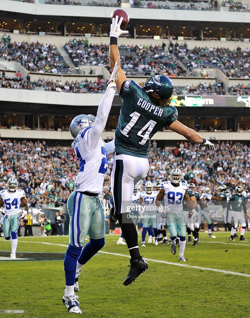 Riley Cooper #14 of the Philadelphia Eagles catches a pass for a touchdown against Morris Claiborne #24 of the Dallas Cowboys at Lincoln Financial Field on November 11, 2012 in Philadelphia, Pennsylvania. The Cowboys won 38-23.