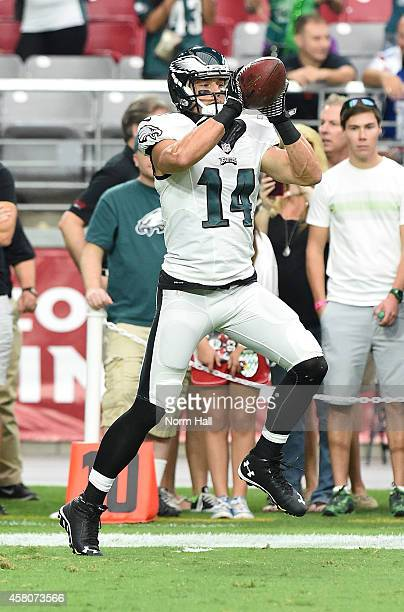 Riley Cooper of the Philadelphia Eagles catches a pass while preparing for a game against the Arizona Cardinals at University of Phoenix Stadium on...