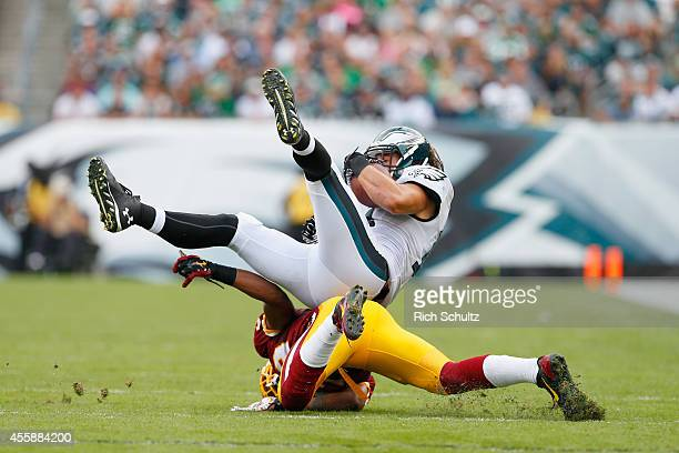 Riley Cooper of the Philadelphia Eagles catches the ball against David Amerson of the Washington Redskins at Lincoln Financial Field on September 21...