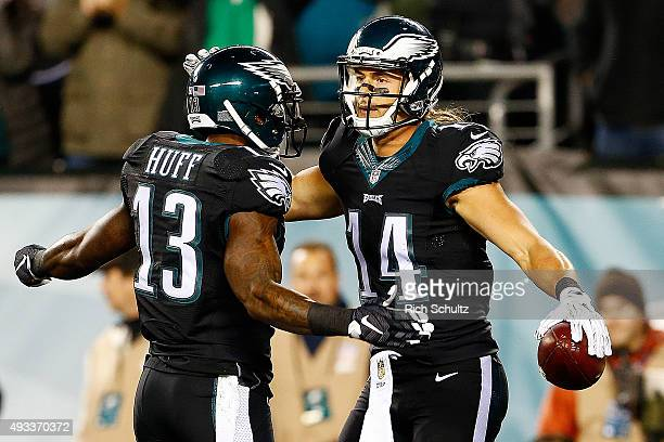 Riley Cooper of the Philadelphia Eagles is congratulated by his teammate Josh Huff after scoring a first quarter touchdown against the New York...
