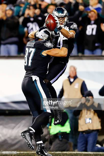 Riley Cooper of the Philadelphia Eagles is congratulated by his teammate Brent Celek after scoring a first quarter touchdown against the New York...