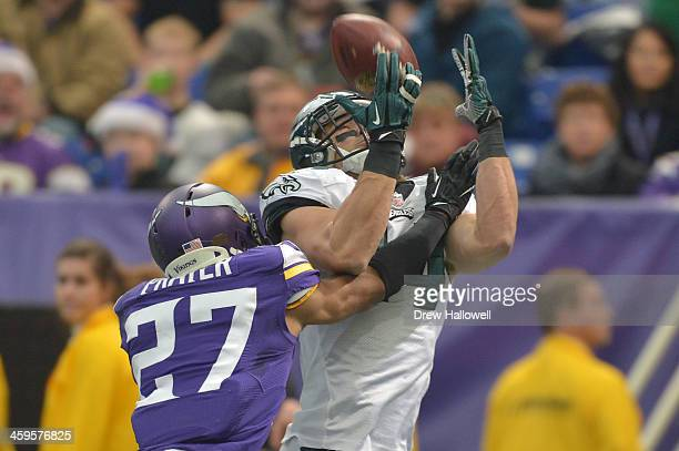 Riley Cooper of the Philadelphia Eagles is defended by Shaun Prater of the Minnesota Vikings at Mall of America Field on December 15, 2013 in...