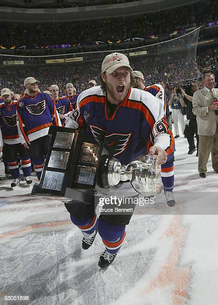 Riley Cote of the Philadelphia Phantoms celebrates the Phantoms 5-2 Calder Cup win over the Chicago Wolves at the Wachovia Center on June 10, 2005 in...