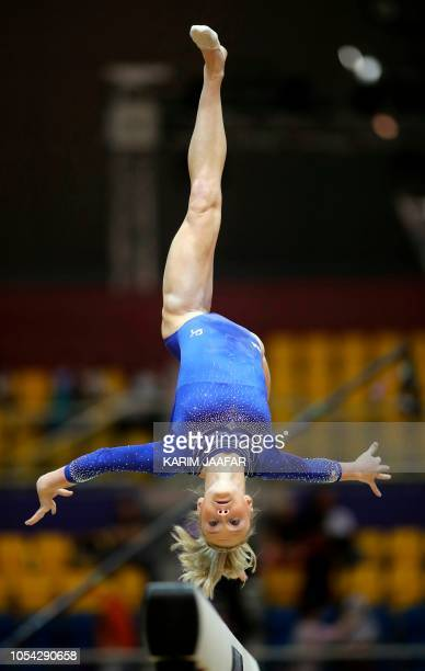 US Riley Cusker competes in the women's balance beam qualification during day three of the 2018 FIG Artistic Gymnastics Championships at Aspire Dome...