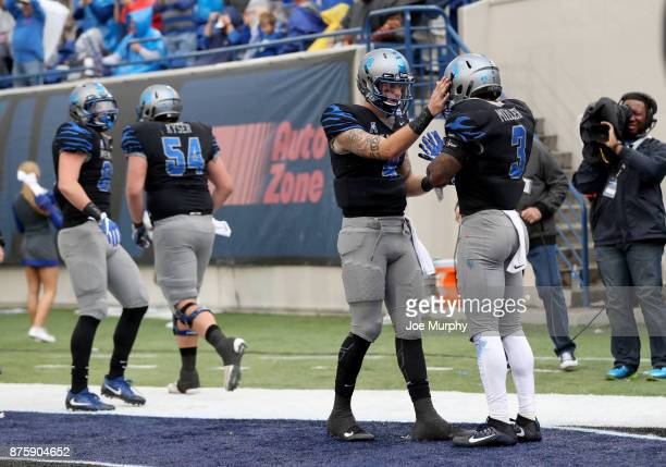 Riley Ferguson and Anthony Miller of the Memphis Tigers celebrate a touchdown against the SMU Mustangs on November 18 2017 at Liberty Bowl Memorial...
