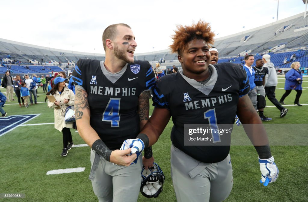 Riley Ferguson #4 and O'Bryan Goodson #1 of the Memphis Tigers celebrate after defeating the SMU Mustangs on November 18, 2017 at Liberty Bowl Memorial Stadium in Memphis, Tennessee. Memphis defeated SMU