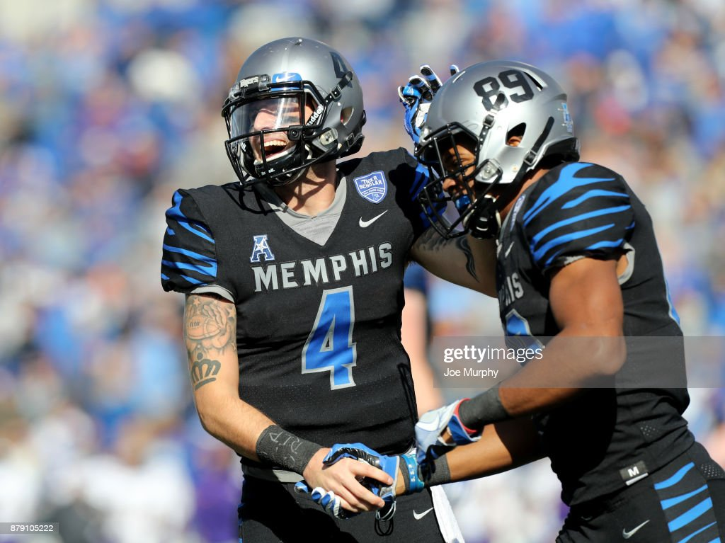 Riley Ferguson #4 and Phil Mayhue #89 of the Memphis Tigers celebrate a touchdown against the East Carolina Pirates on November 25, 2017 at Liberty Bowl Memorial Stadium in Memphis, Tennessee.