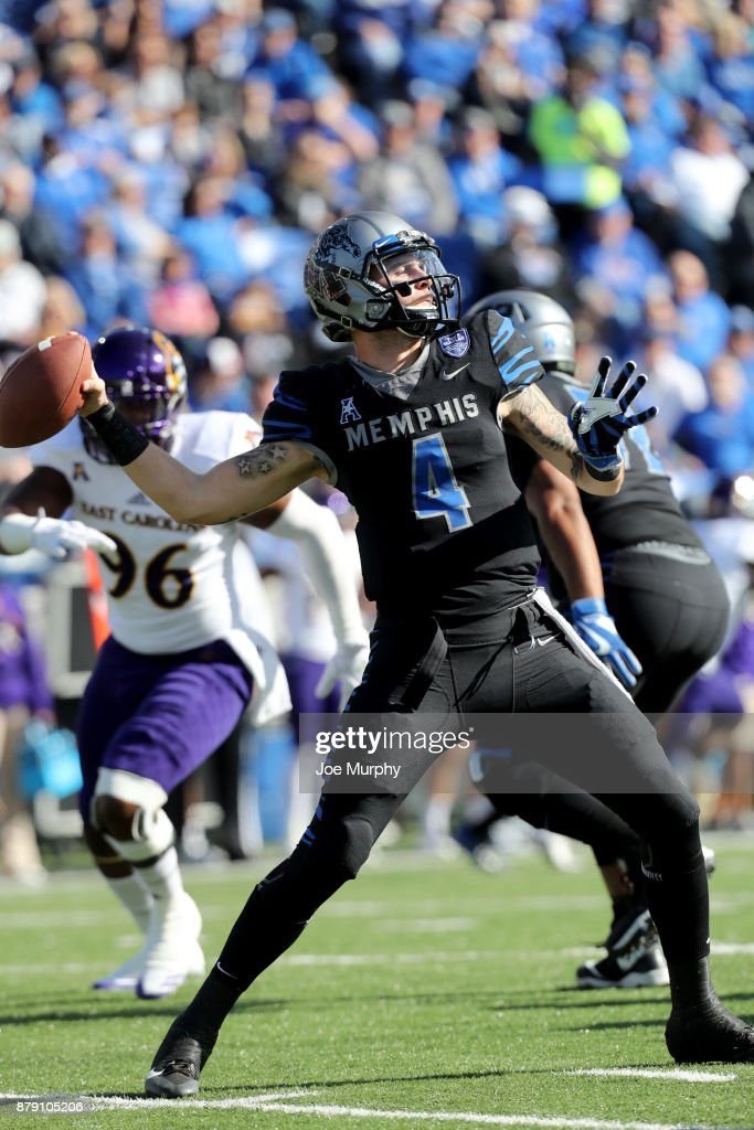Riley Ferguson #4 of the Memphis Tigers drops back to pass against the East Carolina Pirates on November 25, 2017 at Liberty Bowl Memorial Stadium in Memphis, Tennessee.