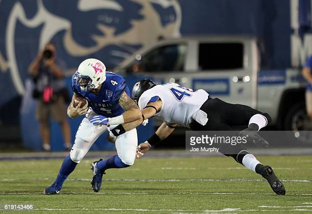 Riley Ferguson of the Memphis Tigers scrambles with the ball against Trent Martin of the Tulsa Golden Hurricane on October 29 2016 at Liberty Bowl...