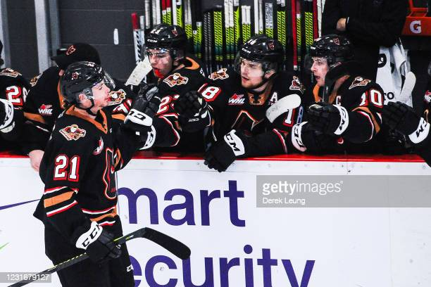 Riley Fiddler-Schultz of the Calgary Hitmen celebrates with the bench after scoring against the Medicine Hat Tigers during a WHL game at Seven Chiefs...