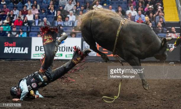 Riley Gagnon of Canada rides Night Shift during the PBR Monster Energy Tour Professional Bull Riders event at Videotron Centre on May 4, 2019 in...