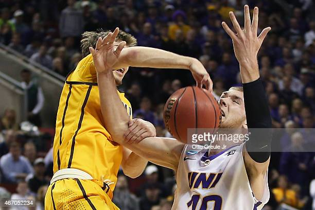 Riley Grabau of the Wyoming Cowboys blocks a shot by Seth Tuttle of the Northern Iowa Panthers during the second round of the 2015 Men's NCAA...