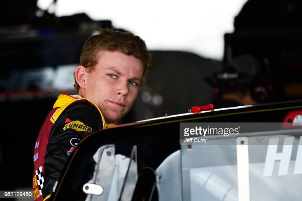 Riley Herbst driver of the Advance Auto Parts Toyota looks on from the garage during practice for the NASCAR Camping World Truck Series Villa...