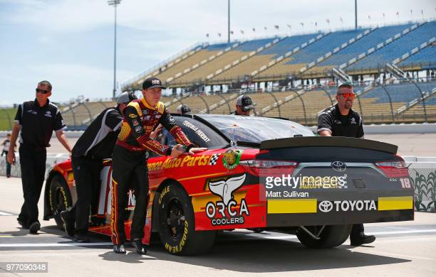 Riley Herbst driver of the Advance Auto Parts Toyota pushes his car during qualifying for the NASCAR Xfinity Series Iowa 250 presented by Enogen at...