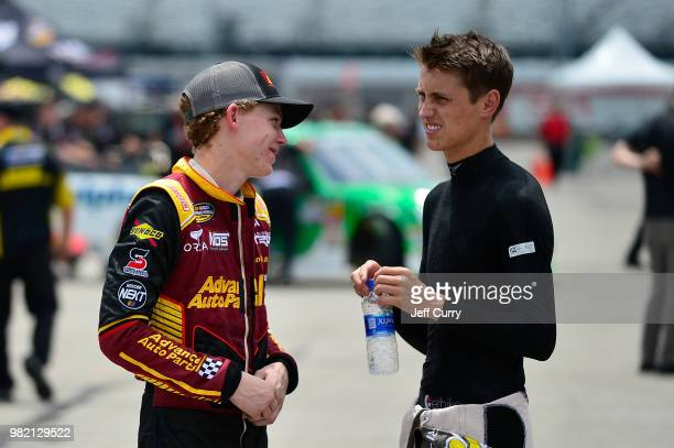 Riley Herbst driver of the Advance Auto Parts Toyota talks with Zane Smith driver of the Crosley Brands/LaPaz Margarita Mix Toyotaduring practice for...