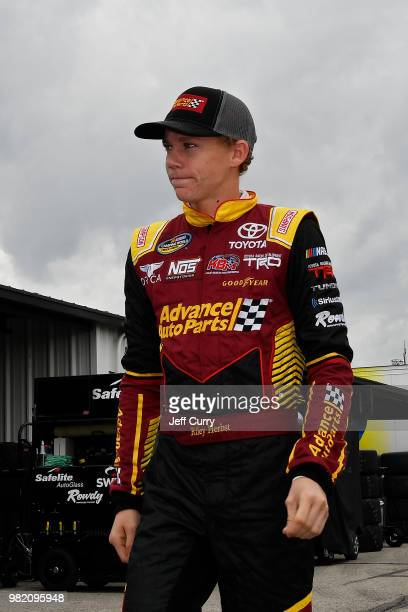Riley Herbst driver of the Advance Auto Parts Toyota walks through the garage during practice for the NASCAR Camping World Truck Series Villa...