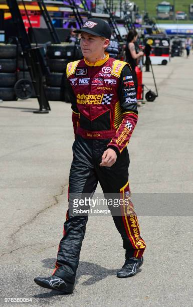 Riley Herbst driver of the Advance Auto Parts Toyota walks to his car during practice for the NASCAR Xfinity Series Iowa 250 presented by Enogene at...