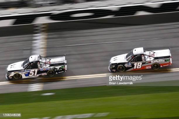 Riley Herbst driver of the Mobil 1 Toyota leads a pack of trucks during the NASCAR Gander RV Outdoors Truck Series NextEra Energy 250 at Daytona...