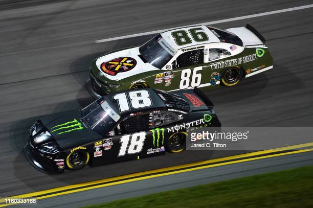 Riley Herbst driver of the Monster Energy Toyota and Brandon Brown driver of the BMSraceteamcom Chevrolet race during the NASCAR Xfinity Series...